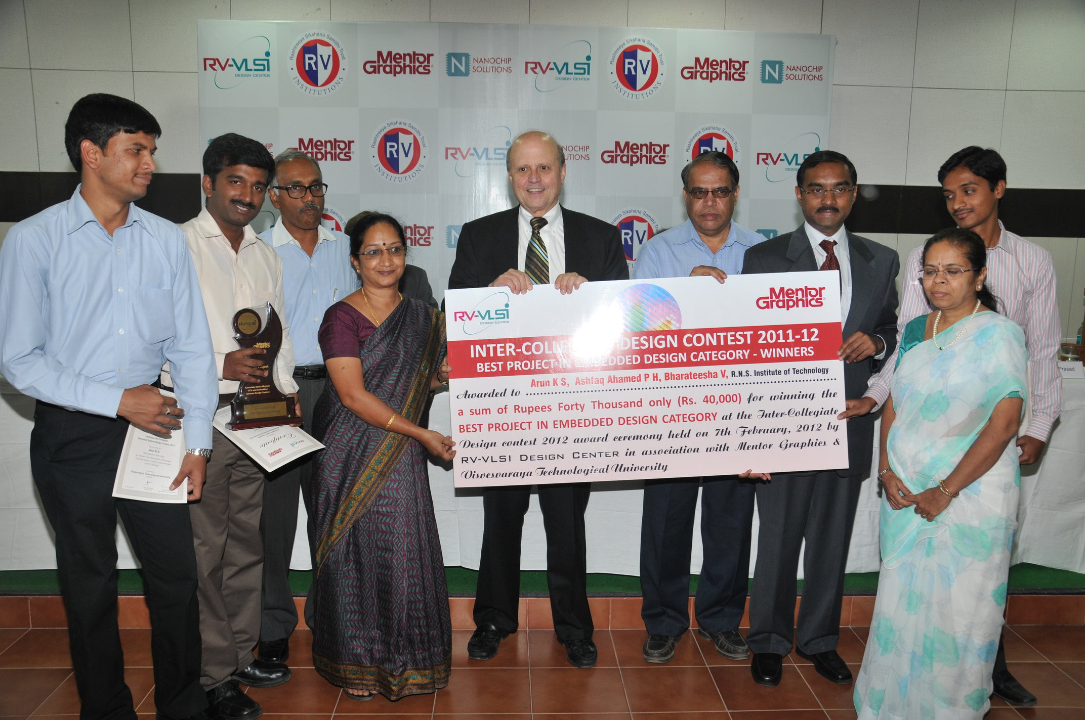 Chairman board of studies VTU, Presenting winners cheque for Best BE Project in VLSI